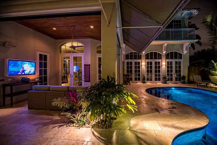 Photo of an outdoor pool at night and LED lighting