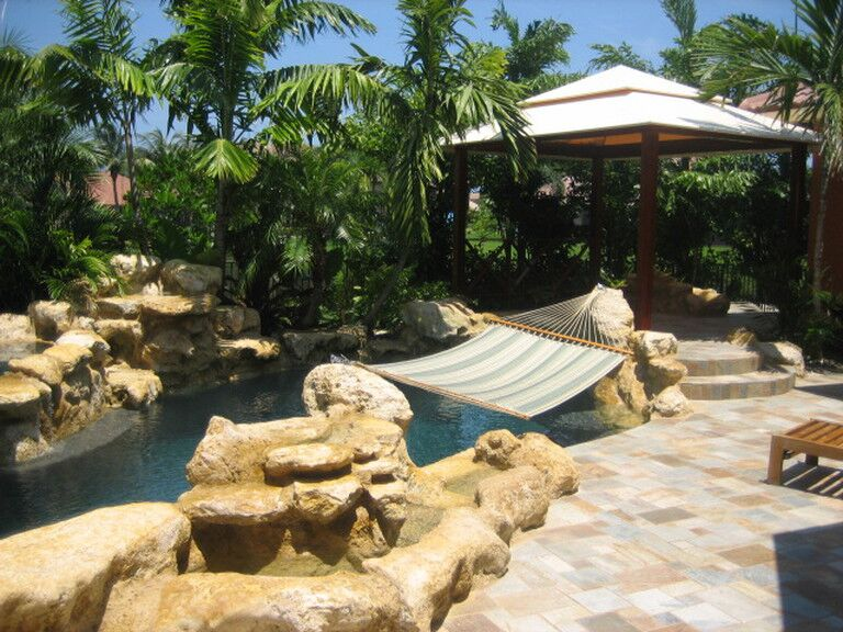 Photo of an outdoor pool with natural stone landscape